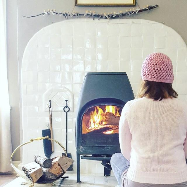 Ahh...my toasty, calm cushion by the fire.