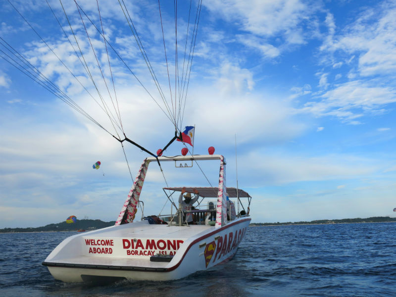 Diamond Water Sports staff waving good bye from boat