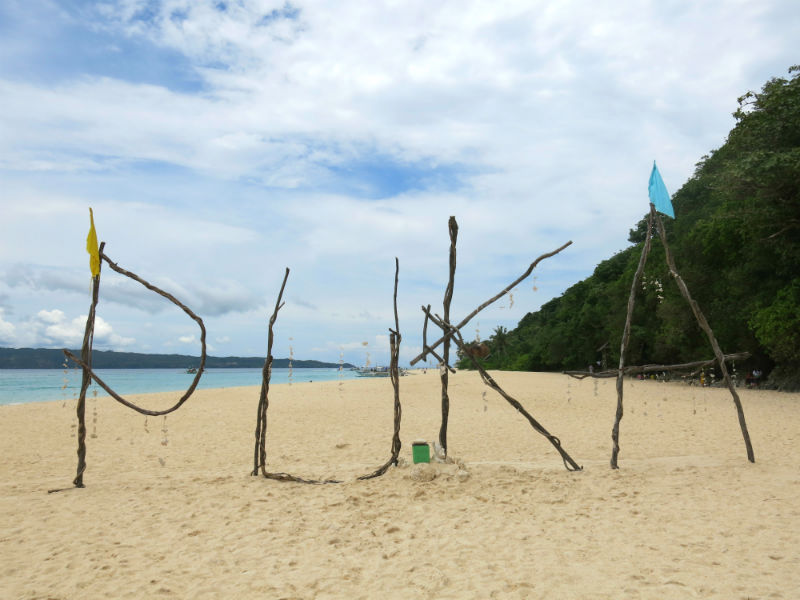 Puka Beach sign built using wood