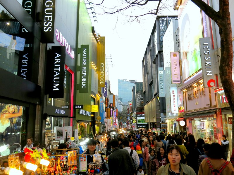 Crowded Itaewon Street with many shops