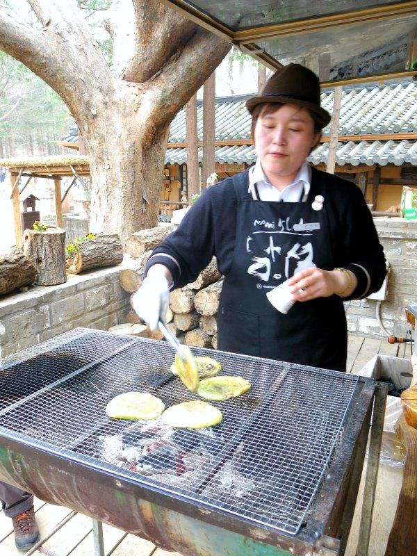 Lady cooking Pan Fried Rice Cake