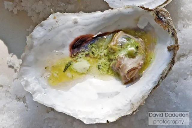 Grilled Plum Point Oyster with a lemon and summer savory butter