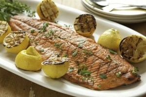 Grilled salmon and lemons with herbs - photo courtesy of Whole Foods Market
