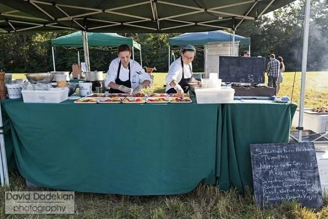 Danielle Lowe and Melissa Denmark preparing salads
