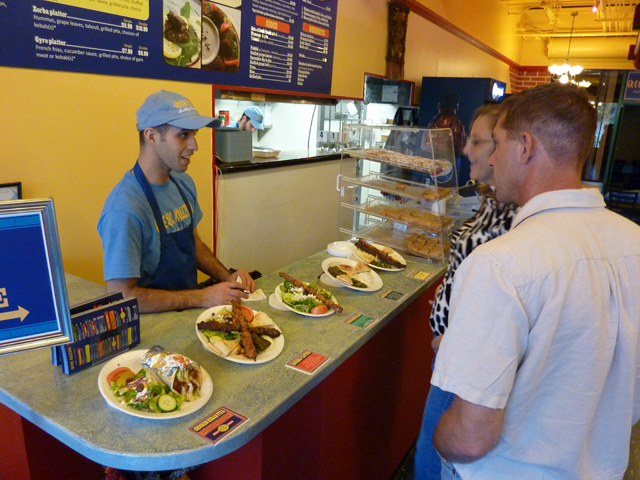 People ordering food at the Greek Kouzina