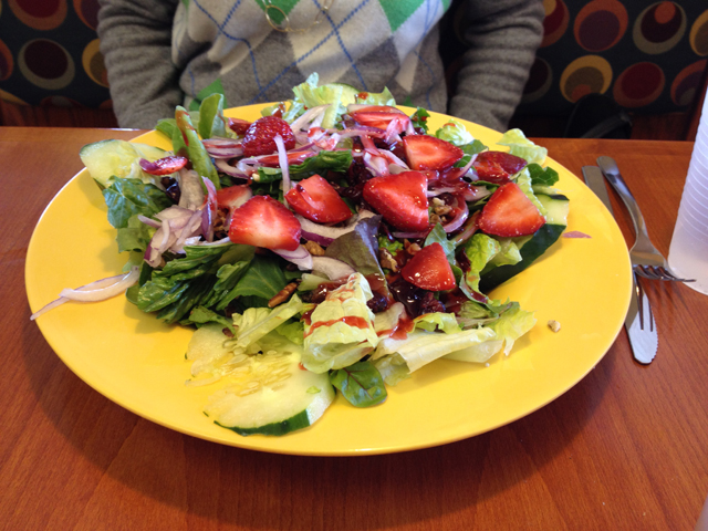 salad covered with fresh strawberries