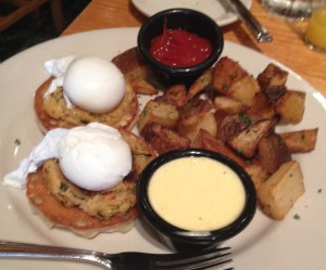 Crab Cake Eggs Benedict: Fresh crab cake griddled and set on a toasted English muffin with poached eggs, and fresh Hollandaise sauce, served with home fries. $14.75