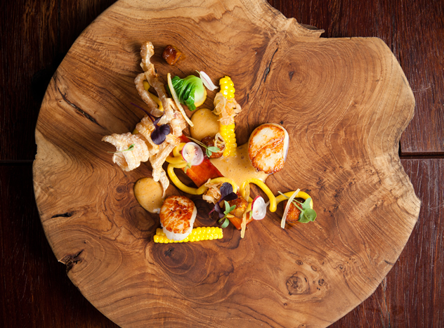 Asian-style scallops and pork belly with kimchi, corn, miso aubergine, crackling, lemongrass and ginger velouté at La Colombe.