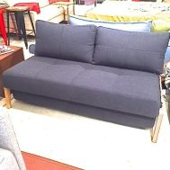 "Cubed love seat wood legs 55""W x 40""D navy fabric.  Floor model $1549"