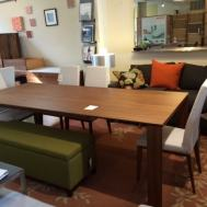 Omnia large walnut table.  Floor Model $1799