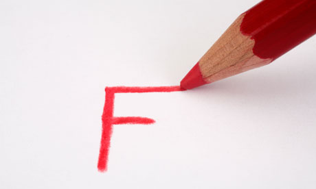 Red pencil marking an F on paper close up. Image shot 2009. Exact date unknown.