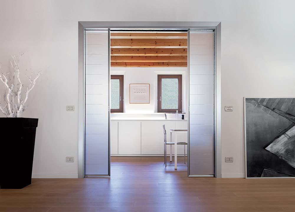 Puertas correderas Tipologia de puerta empotrada - ECLISSE - Modelo De Puertas Corredizas