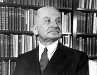 Ludwig von Mises in his library