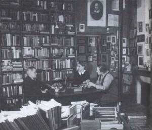 James Joyce, Sylvia Beach, and Adrienne Monnier at Shakespeare and Company, Paris, 1938.  Note the portrait of William Shakespeare at the top of the photograph. Published with permission of Gerry Images.