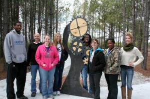 "Lander University assistant professor of art Doug McAbee and his advanced sculpture students pose for a photo with the ""sensory sculpture"" designed by Haley Floyd, a visual art major from Greenwood. Floyd's sculpture, along with those of her classmates, was recently added to the therapeutic riding trail behind Greenwood's Burton Center. From left to right are Jermel Kennedy, of Toronto, Canada; McAbee; Samantha Brown, of Spartanburg; Danielle Tavernier, of Greenville; Fred Parker, of Baton Rouge, La.; Floyd; Bethany Murray, of Ware Shoals; and Whitney Price, of Anderson."