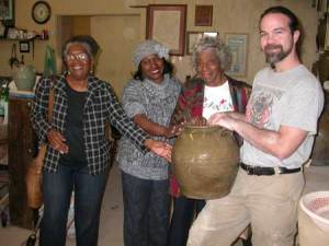 These ladies are touching a Dave pot being held by Justin Guy, potter and the director for the Old Edgefield Pottery Center on Simkins Street, Edgefield.