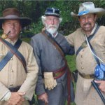 Keck stands with two other re-enactors. The one in the center is from London. There were 400 German re-enactors who came over.