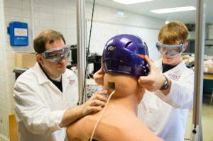 Clemson bioengineering assistant professor David Kwartowitz works with a student Creative Inquiry team conducting research to prevent sports concussions. image by: Craig Mahaffey Clemson University