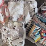 Vintage fabric, tablecloths, lace, rick/rack, embroidery, ribbons and buttons fill baskets and shelves waiting to be selected for the next vintage textile mix project.