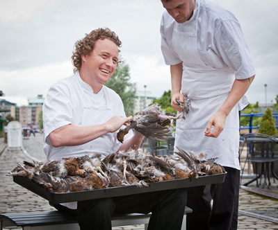 Tom Kitchin plucking grouse