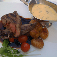 Have it served hot with steak a la minute and a red wine reduction...