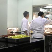Preparing skewers for a tandoor oven.