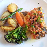 Sea bream with salsa and perfectly cooked vegetables.