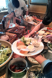 Action shot from the French Market buffet: oysters are being chucked in the background.