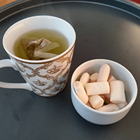 Licorice tea and marshmallows - at-home afternoon tea.