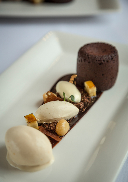 Hot bittersweet chocolate fondant - banana ice cream, salted macadamia nuts, coffee mousse. Photo Brendan MacNeill