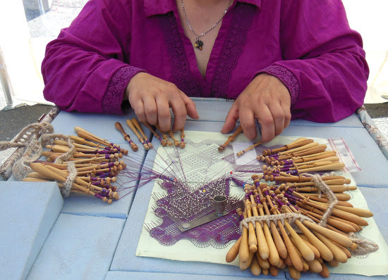 Intricate lace making at Art dans la Rue