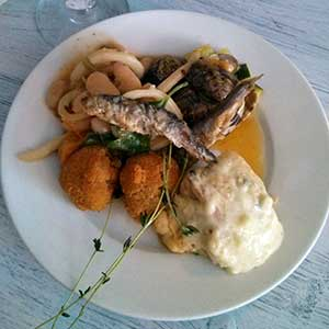 My first plateful: whitebait sit on top of squid and beans, clams, frittata. Locanda de Gusti, Edinburgh.
