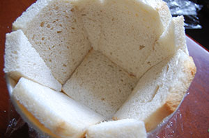 Line the pudding basin with slides of white bread.