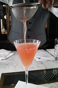Pouring the grapefruit surprise. I'm so looking forward to trying this! Grey Goose.