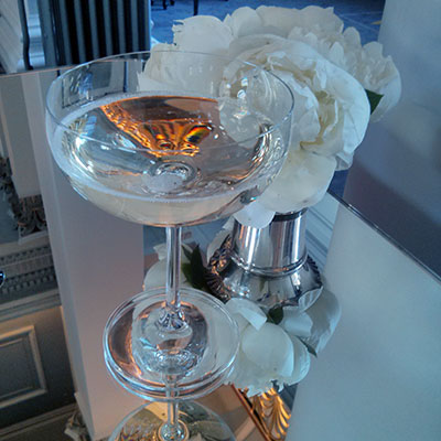 Prosecco, white flowers and glamorous table tops. Colonnades, Edinburgh