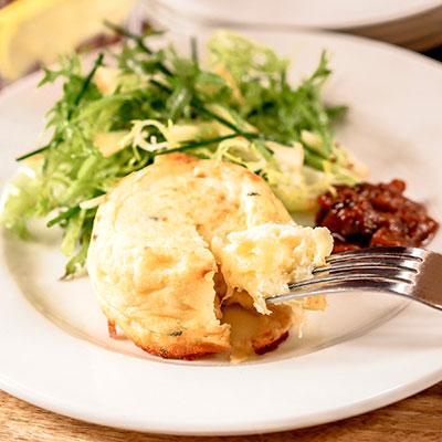 Twice-baked cheese soufflé is a fun way to start the meal.
