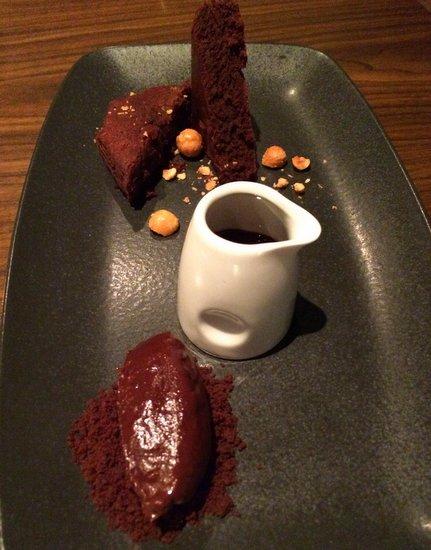 Chocolate cake, chocolate ganache, chocolate sauce, roasted hazelnuts