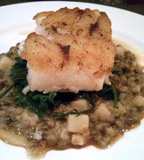 Roast cod on a bed of lentils with celeriac and kale.