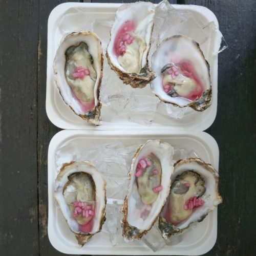Half a dozen oysters on ice
