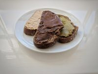 Rye toast with cashewnut butter, home-made and bought chocolate spread and pistachio nut butter.