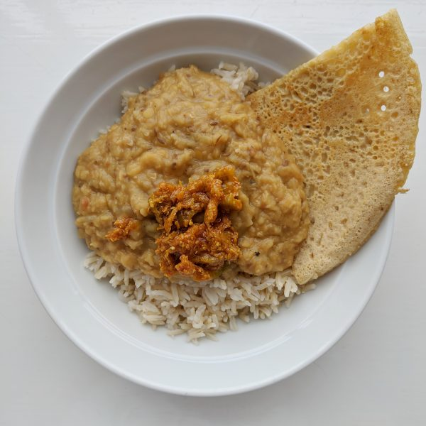 Rice, tarka dahl and gram cake. Also a generous dollop of lime pickle.