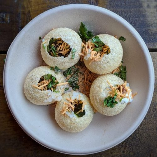 Dahi puri is crispy and soft and generally wonderful. Best enjoyed in company.