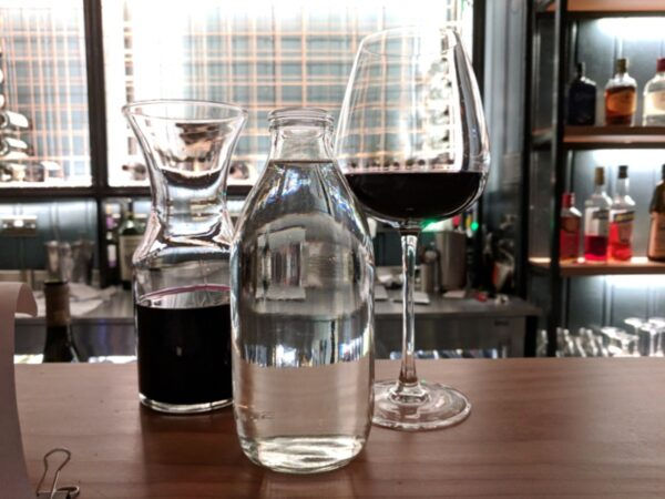 Wine and water in a bar