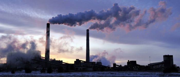 A coal fired plant on a cold day