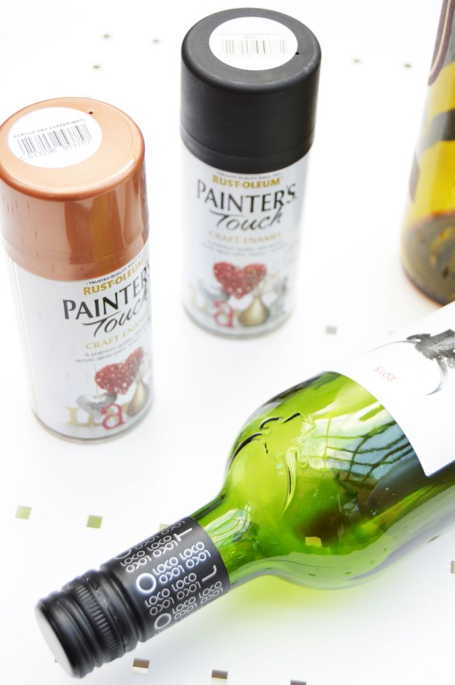 DIY wine bottle candle holder is easy to make and all you need is spray paint and wine bottles. With just painting the bottles, you can turn them into something stylish and pretty.