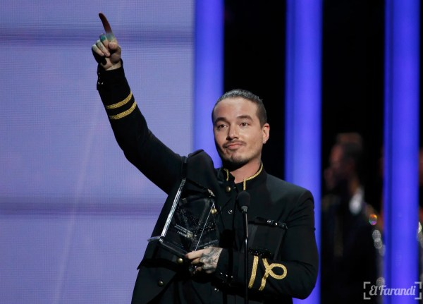Singer J. Balvin celebrates after winning three awards at the 2015 Latin Billboard Awards in Coral Gables, Florida April 30, 2015. REUTERS/Carlo Allegri
