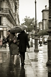 Couple walking in rain in Paris by four12_Flickr_2480754339_894bc0cf50_z