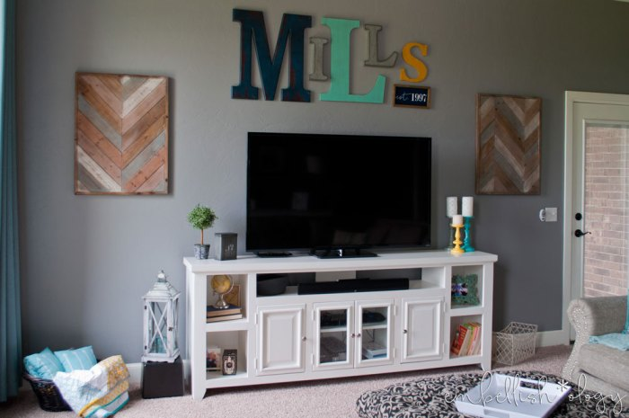 This Fixer Upper inspired wall decor using random letters adds a fun personal touch to our family room.