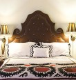 I love the shape unusual shape of this headboard.  The piping and buttons make a bold statement too.  Image from   Laurens&#039; Style Library