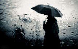 sad-lonely-alone-boy-walking-in-rain-with-umbrella-in-hand-photo-wide